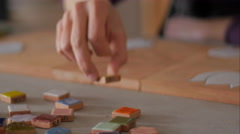 Ceramic maker selecting color samples close-up Stock Footage
