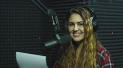 A radio DJ reads news in the broadcasting studio Stock Footage