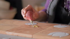Ceramic maker using plastic bulb Stock Footage
