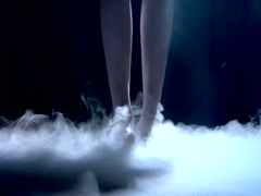Girl dancing in misty dreamy atmospheric smoke - stock footage