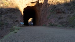 People on a trail entering a tunnel - stock footage