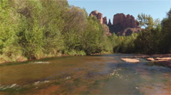 Beautiful river running under Red Rock Cathedral mountain in Sedona - stock footage