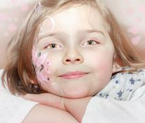 young girl with body painting on face - stock photo
