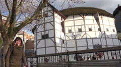 Shakespeare's globe theatre with passersby London, UK, April 2016 Stock Footage