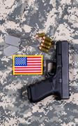 USA Flag patch on military uniform with weapon and ammo - stock photo