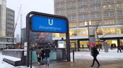 People enter Alexanderplatz subway ubahn train station, winter snow, Berlin Stock Footage