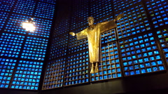 Golden Jesus statue, inside Kaiser Wilhelm Memorial Church, Berlin Stock Footage