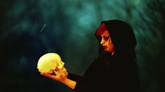 Bizarre witch creepy skull halloween concept Stock Footage