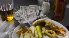 Leftover food and money on the counter, close up Stock Footage