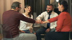 Happy people hold hands during therapy at psychologist - stock footage