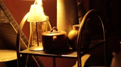 Art lamp on top of small forniture Stock Footage