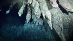 Ocean scenery deeper into the cave exploring stalactites in pitch blackness, in Stock Footage