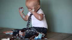 Toddler waives his arms at cakesmash Stock Footage