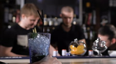 Bartenders at work in the club, prepared alcoholic cocktails, talk to each other Stock Footage