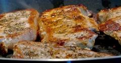 Home Preparing Of Pork Chops In Pan Stock Footage