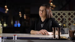 The bartender puts an exclusive cocktail for the attractive brunette. Good humor - stock footage