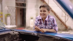6-Boy Fixing Car Engine Gives Five To Grandpa Stock Footage