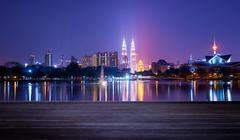 Night view of Kuala Lumpur city with stunning reflection in water and wooden - stock photo
