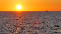 4K Yellow Sun and Orange Sky, Sail boat with Setting Golden Hour Sun Stock Footage