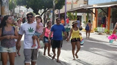 People walking on the main street in Porto Galinhas Stock Footage