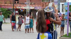 Man dancing typical Brazilian song on the street. Stock Footage