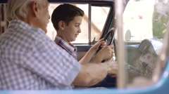 13-Portrait Grandpa Giving Driving Lesson To Boy In Old Car Stock Footage