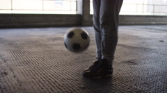 Handheld mid shot of soccer freestyle player doing tricks with the football Stock Footage