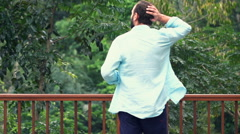 Man walking on terrace and admire view, super slow motion 120fps Stock Footage