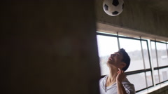 Soccer player doing headers Stock Footage