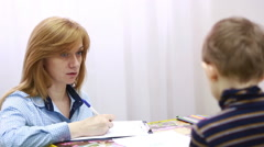 Psychologist is testing the boy. Psychological counseling Child Stock Footage