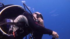 Male model scuba diver in lagoon entrance channel in Palau (Micronesia), HD, Stock Footage