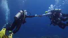 Ocean scenery dive instructor trying to control novices, poor divers, muppets, Stock Footage