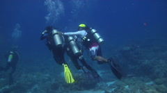 Chaotic hoard of scuba divers swimming in lagoon entrance channel in Palau Stock Footage