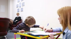 psychologist is testing the boy. Psychological counseling Child - stock footage