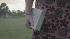 Girl holding book Stock Footage