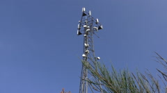 Telecommunications tower against blue sky Stock Footage