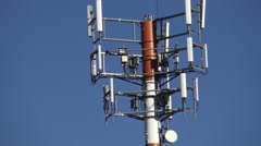 Antenna cellular signal mobile phone tower in blue sky Stock Footage
