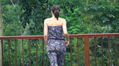 Woman walking on terrace and admire view, super slow motion 120fps - stock footage