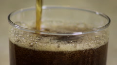 Soda being poured into a glass in a kitchen, extreme close up Stock Footage
