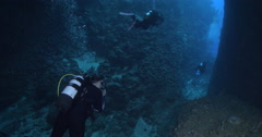 Group of scuba divers swimming in overhang in Solomon Islands, 4K UltraHD, Stock Footage