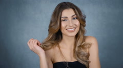 Happy young woman with perfect smile isolated on grey background. - stock footage