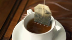 Making tea in cup, super slow motion 240fps Stock Footage