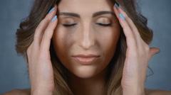 Beautiful girl doing self head massage. Stock Footage