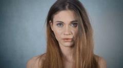 Portrait of beautiful sad woman posing in studio. Stock Footage