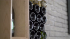 Old wine collection, by white brick wallbackground. 4k - stock footage