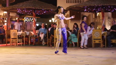 Girl dancing in the evening at the hotel in Egypt Stock Footage