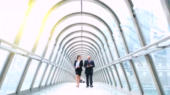Business people walking and talking in financial district Stock Footage