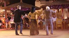 Egyptian woman teaches men dancing outdoors Arkistovideo