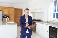 Realtor Looking Around Vacant New Property - stock photo