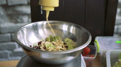 Close up of watering lettuce mayonnaise in bowl on a weigh 4k - stock footage